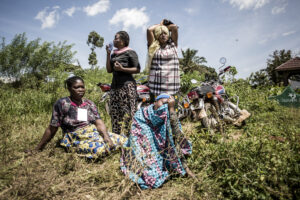 Women mourn the death of a family member during a funeral on the outskirts of Beni, North Kivu.